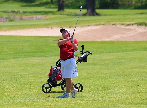 Goshen's Chase Meyer looks up after swinging for the green from the fairway during Saturday's NLC Championship Invitational at Bent Oak Golf Club in Elkhart.