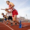 Goshen Cole Johnston (823) starts in the 4 x 800 meter relay during Thursday's sectional at Goshen High School in Goshen.