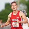 Goshen Drew Hogan (822) reacts after winning the 1600 meter run during Thursday's sectional at Goshen High School in Goshen.