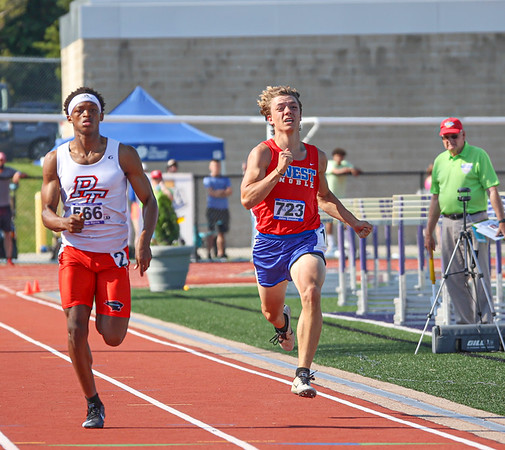 West Noble junior Jalen Gonzalez (723) comes down the stretch during a 200-meter dash prelim race at the IHSAA state boys track and field finals Friday at Ben Davis High School in Indianapolis.