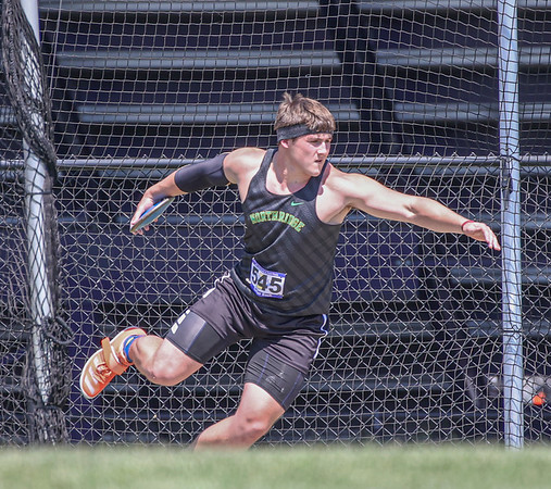 Northridge senior Carter Bach competes in the discus throw event at the IHSAA state boys track and field finals Friday at Ben Davis High School in Indianapolis. Bach would finish seventh, earning all-state honors.