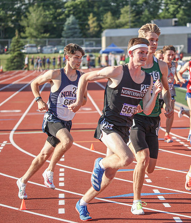 NorthWood junior Brady Hunsberger (563) makes a move in an outside lane during the 1,600-meter run at the IHSAA state boys track and field finals Friday at Ben Davis High School in Indianapolis.