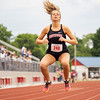 NorthWood's Alea Minnich (240) prepares for her race during Tuesday's regional at Goshen High School.