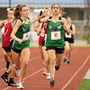 Samia Latif (47) exchanges the baton to her teammate Delaney Trigg (54) during Tuesday's regional at Goshen High School.