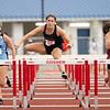 Northridge's Alyssa Sloop (223) jumps in the 100 meter hurdles during Tuesday's regional at Goshen High School.
