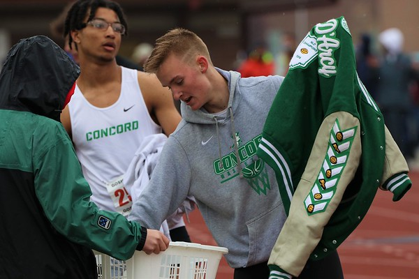 Concord's Jack D'Arcy collects his belongings after finishing the Class A high hurdle event during the Goshen Relays on Saturday at Goshen High School.