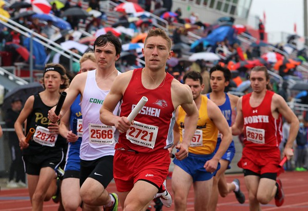 Goshen's Drew Hogan leads the pack at the beginning of the Class A distance medley relay during the Goshen Relays on Saturday at Goshen High School.