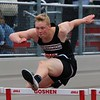 NorthWood's Noah Blosser hurdles during the Class B high hurdle event at the Goshen Relays on Saturday at Goshen High School.