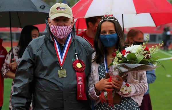 Sophia Koshmider, right, poses with Larry Biller after she was named queen of the Goshen Relays on Saturday at Goshen High School. Biller was the honorary referee for the event.