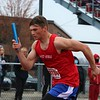 West Noble's Nolan Parks accelerates at the start of the Class B 4x100-meter relay during the Goshen Relays at Goshen High School on Saturday.