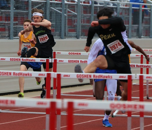 Northridge's Mason Floria (2826) jumps during the Class A high hurdle event at the Goshen Relays on Saturday in Goshen.