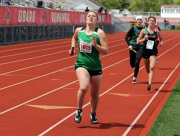 Concord's Aubrey Morris (1665) competes in the sprint medley relay at the Goshen Girls Relays Saturday in Goshen.