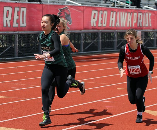 Wawasee's Alissa Gill, front left, takes a handoff from teammate Kaydence Shepherd during the 4x200-meter relay race at the Goshen Girls Relays Saturday in Goshen. Also pictured is Goshen's Abigal Unrue.