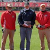 Steve Caswell, from left, Dean Slavens and Ray Streit take a picture after accepting the honorary referee plaque for Ron Fecher, who was unable to attend the Goshen Girls Relays Saturday due to illness.