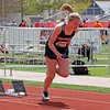 NorthWood's Ainsely Miller fires off the blocks at the start of the freshman relay at the Goshen Girls Relays Saturday in Goshen.