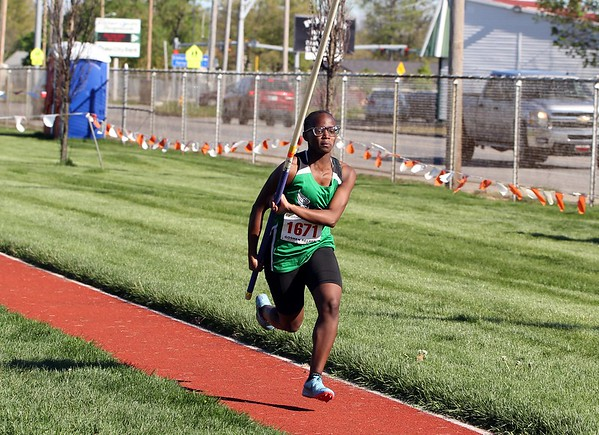 Concord's Joyce Odhiambo runs down the track for one of her pole vault attempts during the Goshen Girls Relays Saturday in Goshen.