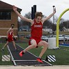 Goshen's Lincoln Clark looks to stick the landing on the long jump during Tuesday's track meet against Elkhart in at Elkhart High School.