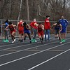 Members of the Goshen and Elkhart boys track team fire off the starting blocks at the beginning of the 100-meter dash Tuesday at Elkhart High School. It was the first outdoor track meet for either school since 2019 after the COVID-19 pandemic canceled the 2020 spring sports season.