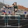 Wawasee's Dylan Konieczny, center, leaps over a hurdle during the 100-meter hurdles event Tuesday against West Noble in Syracuse.
