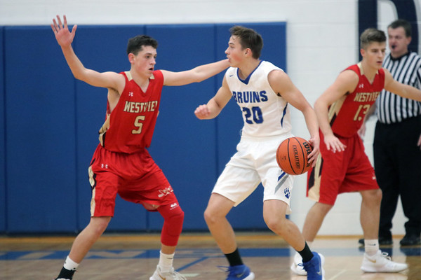 GREG KEIM   THE GOSHEN NEWS<br /> Bethany Christian senior Lucas Brownsberger-Keyes (20) tires to work the ball while being guarded by Westview sophomore Charlie Yoder (5) in a high school boys basketball game Tuesday night at Bethany Christian.