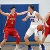 GREG KEIM | THE GOSHEN NEWS<br /> Bethany Christian senior Lucas Brownsberger-Keyes (20) tires to work the ball while being guarded by Westview sophomore Charlie Yoder (5) in a high school boys basketball game Tuesday night at Bethany Christian.
