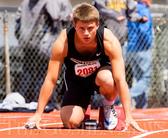 JAY YOUNG   THE GOSHEN NEWS<br /> NorthWood's Brayton Yoder gets set in his block as he waits for the gun to signal the start of the sprint medley relay during the 75th running of the Goshen Relays Saturday at Goshen High School.