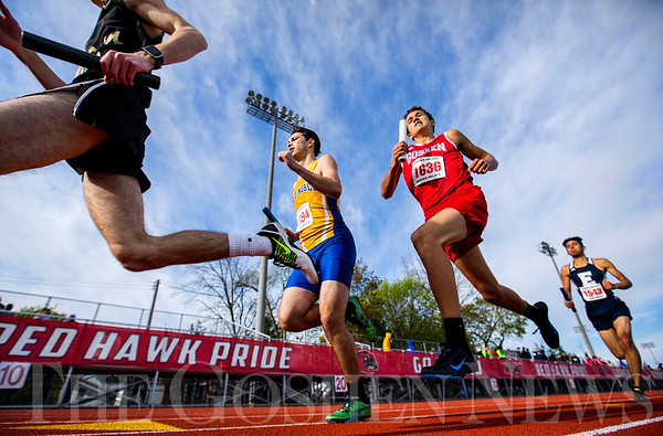 JAY YOUNG | THE GOSHEN NEWS<br /> Goshen's Bryant Grewe (1636) and East Noble's Adam Dills (1494) run side-by-side as they compete in the distance medley relay during the 75th running of the Goshen Relays Saturday at Goshen High School.