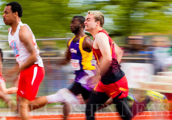 JAY YOUNG | THE GOSHEN NEWS<br /> Elkhart Memorial's Travis Culp tries to keep pace while competing in the 100 meter dash trials during the 75th running of the Goshen Relays Saturday at Goshen High School.