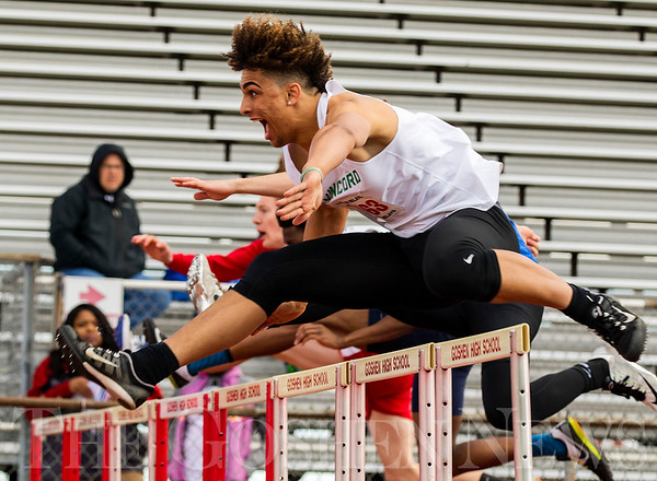 JAY YOUNG   THE GOSHEN NEWS<br /> Concord's Damien Jackson lets out a yell as he clears a hurdle while competing in the 110 meter high hurdle trials during the 75th running of the Goshen Relays Saturday at Goshen High School.