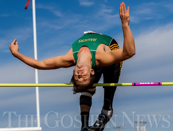 JAY YOUNG   THE GOSHEN NEWS<br /> Northridge's Sam Grewe clears the bar while competing in the high jump during the 75th running of the Goshen Relays Saturday at Goshen High School.