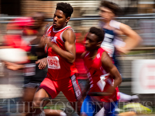 JAY YOUNG | THE GOSHEN NEWS<br /> After taking the hand off, Goshen's Rummel Johnson (1642) tries to get out in front while competing in the sprint medley relay during the 75th running of the Goshen Relays Saturday at Goshen High School.