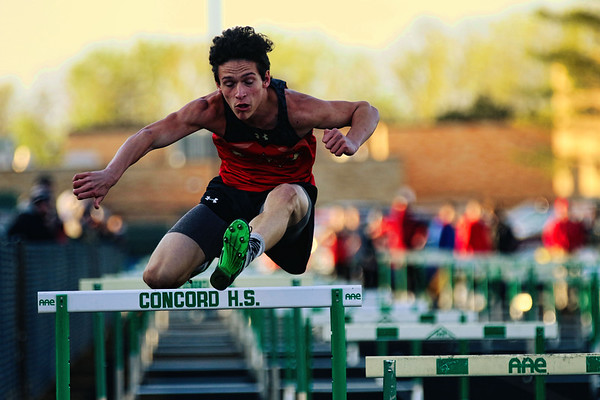JAY YOUNG | THE GOSHEN NEWS<br /> Westview High's Jeremy Miller clears a high hurdle as he competes in the hurdle relay at the 47th annual Kelly Relays Friday evening at Concord High School.