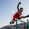 JAY YOUNG | THE GOSHEN NEWS<br /> Goshen High's Franko Hernandez clears a hurdle while competing in the hurdle relay at the 47th annual Kelly Relays Friday evening at Concord High School.
