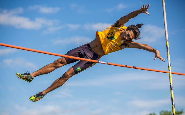 JAY YOUNG | THE GOSHEN NEWS<br /> Northridge's Logan Riffell releases the pole as he clears the bar while competing in the pole vault event at the 47th annual Kelly Relays Friday evening at Concord High School.