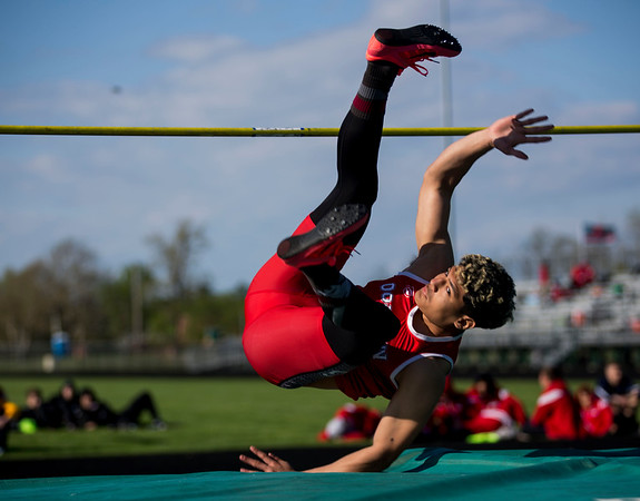 JAY YOUNG | THE GOSHEN NEWS<br /> Goshen High's Rene Gutierrez lands after clearing the bar while competing in the high jump event at the 47th annual Kelly Relays Friday evening at Concord High School.
