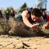 JAY YOUNG | THE GOSHEN NEWS<br /> Sand flies up as NorthWood's Bronson Yoder lands while competing in the long jump event at the 47th annual Kelly Relays Friday evening at Concord High School.