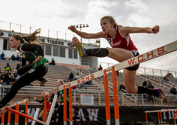 JAY YOUNG   THE GOSHEN NEWS<br /> Goshen High's Jillian Kissinger clears a hurdle as she competes in the finals of the 100 meter hurdles during the Norther Lakes Conference Championship track meet Tuesday evening in Warsaw.