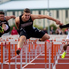 JAY YOUNG | THE GOSHEN NEWS<br /> Northwood's Jacob Stump clears the final hurdle to take first place in the finals of the 110 meter hurdles during the Norther Lakes Conference Championship track meet Tuesday evening in Warsaw.