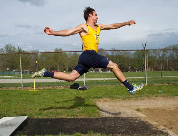 SAM HOUSEHOLDER | THE GOSHEN NEWS<br /> Fairfield quarterback Zach Wagler does the long jump Friday during the 44th Kelly Relays at Concord High School.