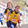 SAM HOUSEHOLDER   THE GOSHEN NEWS<br /> Fairfield's Mitch DeWitt (1525) takes off after receiving the baton from teammate Konrad Dallas during a Class B relay race at the Goshen Relays Saturday. Around 40 teams participated in the 72nd running of the event.