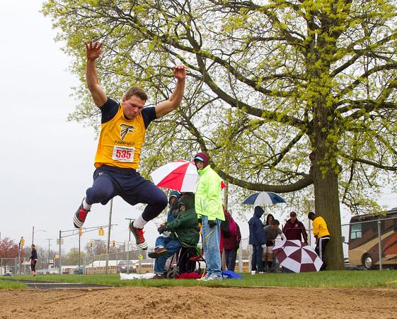 SAM HOUSEHOLDER | THE GOSHEN NEWS<br /> Fairfield athlete Mitch DeWitt does a long jump trial Saturday during the Goshen Relays.