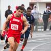 SAM HOUSEHOLDER | THE GOSHEN NEWS<br /> Goshen runner Abe Medellin runs the 4x200 meter relay during the 73rd Goshen Relays Saturday.