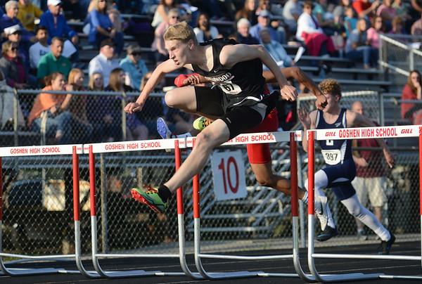 HALEY WARD | THE GOSHEN NEWS<br /> NorthWood senior Derek Parker jumps over a hurdle during the Boys 110 Meter Hurdles on Thursday during the Goshen Sectionals.