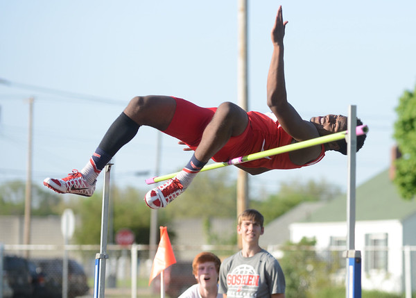 HALEY WARD   THE GOSHEN NEWS<br /> Goshen junior Rummel Johnson leaps over the bar in the high jump Thursday during the Goshen Sectionals. Johnson finished first in the event.