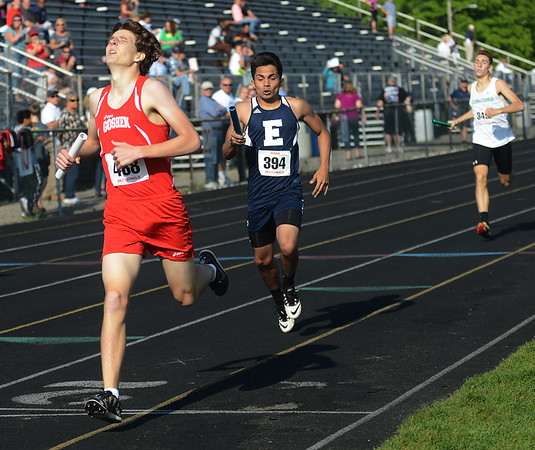 HALEY WARD | THE GOSHEN NEWS<br /> Goshen junior Zach Oyer crosses the finish line to finish first in the Boys 4x800 Meter Relay on Thursday during the Goshen Sectionals.