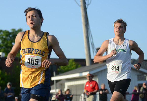 HALEY WARD | THE GOSHEN NEWS<br /> Fairfield senior Mason Kintigh and Concord junior Brandon Alley compete in the 1600 meter run Thursday during the Goshen Sectionals.