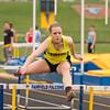 SAM HOUSEHOLDER | THE GOSHEN NEWS<br /> Fairifeld junior Jessica Miller runs the 100 meter hurdles during the track meet Thursday against Lakeland.