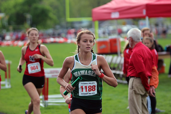 GREG KEIM | THE GOSHEN NEWS<br /> Tenaya Krill, No. 1188 of the Wawasee Warriors, leads No. 964 Maddie Scarpone in the Class A distance medley relay Saturday at the Goshen Girls Relays.