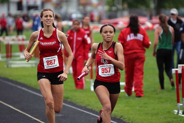 GREG KEIM   THE GOSHEN NEWS<br /> Hannah Kurtz, No. 887 of the Goshen RedHawks tries to catch No. 957 Amani Miles of North Central in the Class A 4 x 400-meter relay Saturday at the Goshen Girls Relays.