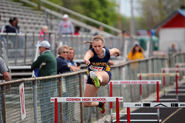 GREG KEIM | THE GOSHEN NEWS<br /> Jessica Miller of the Fairfield Falcons competes in the Class B shuttle hurdle relay Saturday at the Goshen Girls Relays.